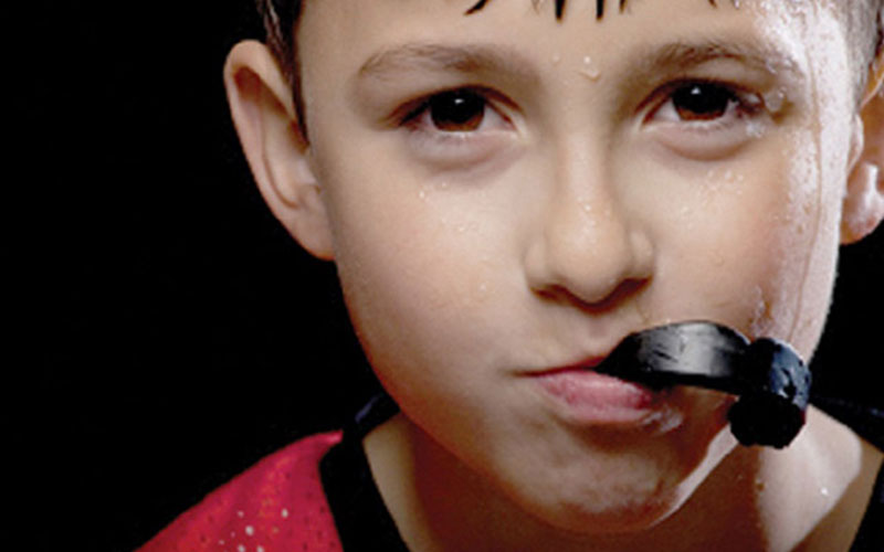 Why Your Child Needs a Mouthguard - Aesthetic Dental and Denture Clinic